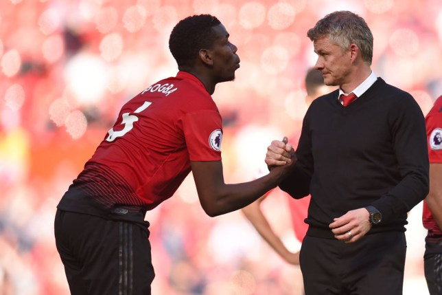 Ole Gunnar Solskjaer shakes hands with Paul Pogba after defeat to Cardiff