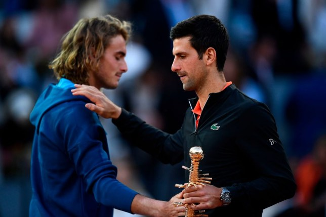 Novak Djokovic pats Stefanos Tsitsipas on the shoulder after winning the Madrid Open