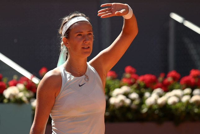 Azarenka blocking the sun with her hand