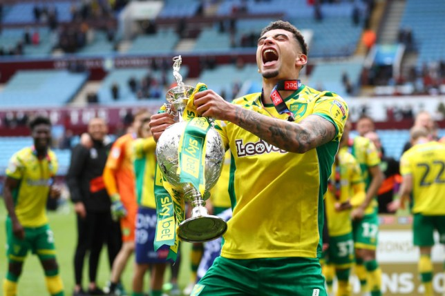 BIRMINGHAM, ENGLAND - MAY 05: Ben Godfrey of Norwich City lifts the championship trophy in celebration after the Sky Bet Championship match between Aston Villa and Norwich City at Villa Park on May 05, 2019 in Birmingham, England. (Photo by Matthew Lewis/Getty Images)
