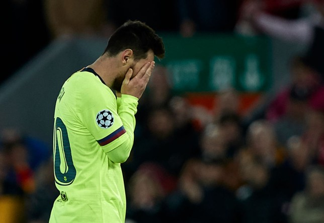 Lionel Messi holds his head in his hands after the game against Liverpool