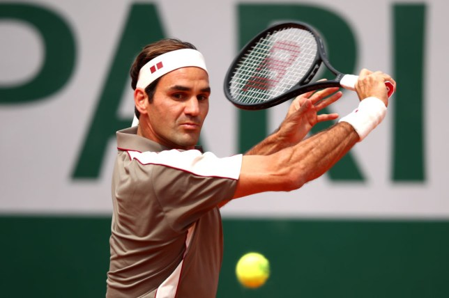Roger Federer hits a backhand on his return to the French Open