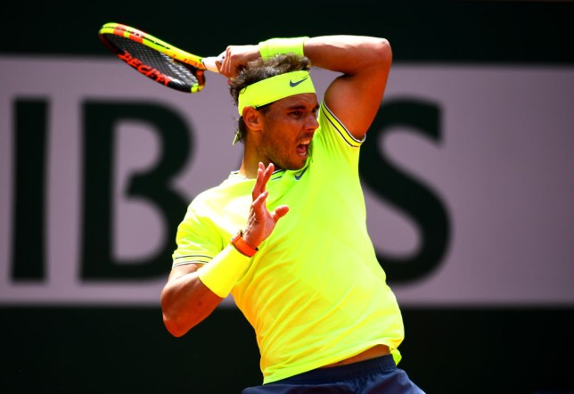 Rafael Nadal hits a forehand in his French Open round two win