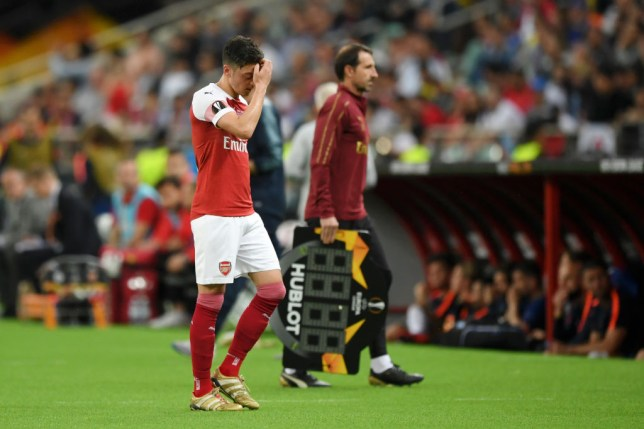 Mesut Ozil walked slowly off the pitch after being taken off in the 76th minute