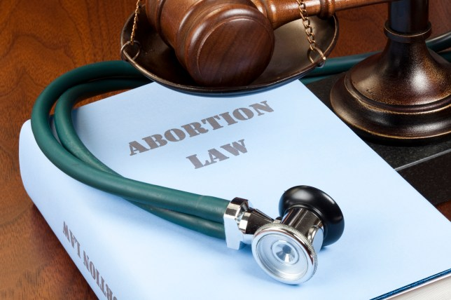 Book of abortion law in a courtroom