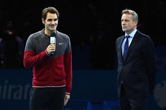 Roger Federer with ATP president Chris Kermode