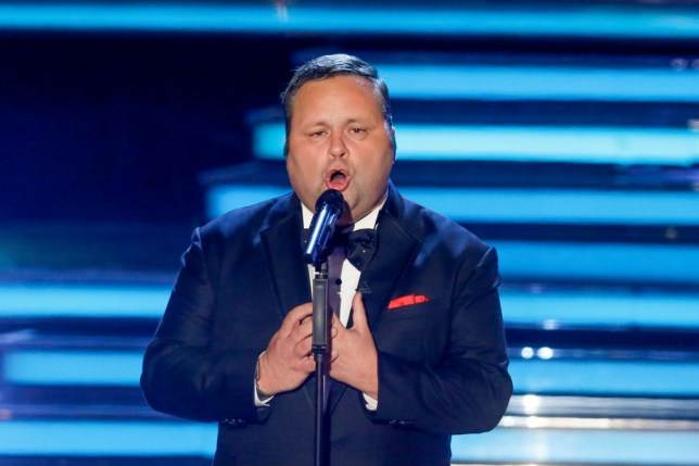 Paul Potts on stage singing