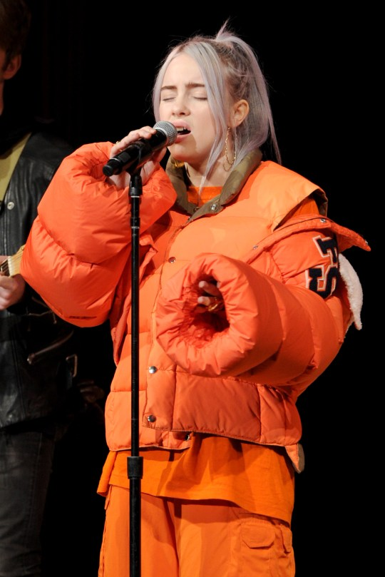 Billie Eilish wears baggy clothes so people 'can't judge her body' and fans are not happy