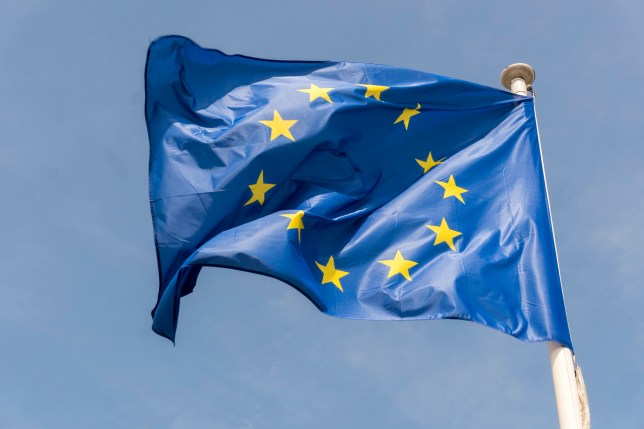 European Union flag flying outside Berlaymont building of the European Commission in Brussels, Belgium