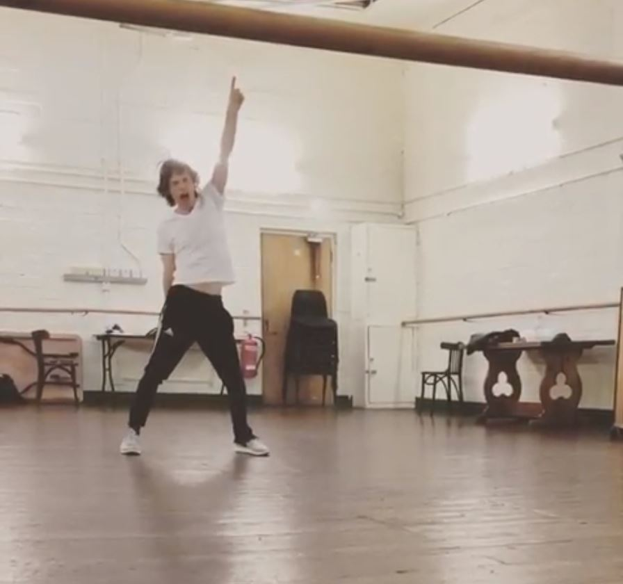 Rolling Stones star Mick Jagger behind to his dancing self