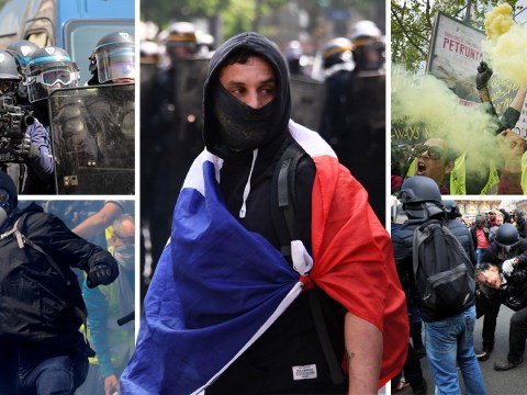Tear gas fired as police and protestors clash during riots in Paris