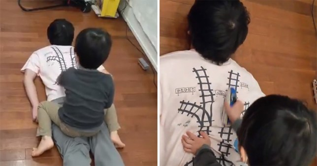 Dad designs t-shirt with train tracks on so he gets a free massage when his son plays