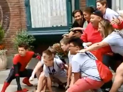 The cast of Spider-Man surprised fans at Disneyland with a sneaky photobomb