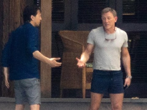 Daniel Craig doesn't look happy during 'heated chat' with Bond 25 director Cary Fukanaga