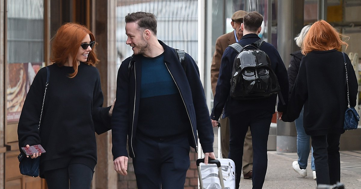 Stacey Dooley and Kevin Clifton pictured holding hands in PDA