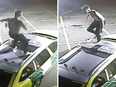 Hunt for topless thug who jumped up and down on ambulance