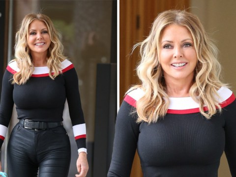 Carol Vorderman looks pleased with herself after 'shoe condom' blunder on live TV
