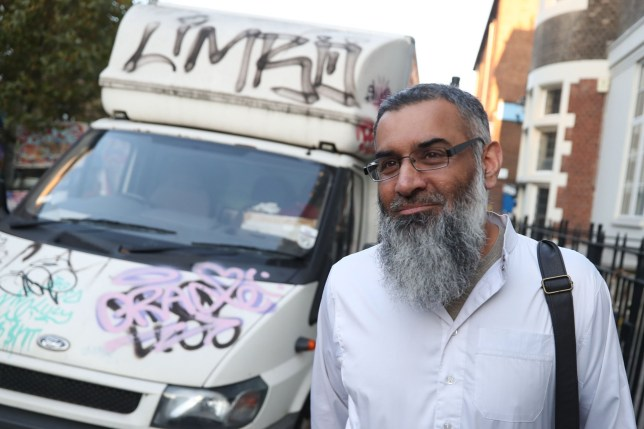 Radical cleric Anjem Choudary is seen leaving a probation hostel in London on October 19, 2018 following his release from prison. - Radical cleric Anjem Choudary, long a thorn in the side of British authorities, was released from prison on October 19 having served half his sentence for encouraging support for the Islamic State group, British media reported. (Photo by Daniel LEAL-OLIVAS / AFP) (Photo credit should read DANIEL LEAL-OLIVAS/AFP/Getty Images)