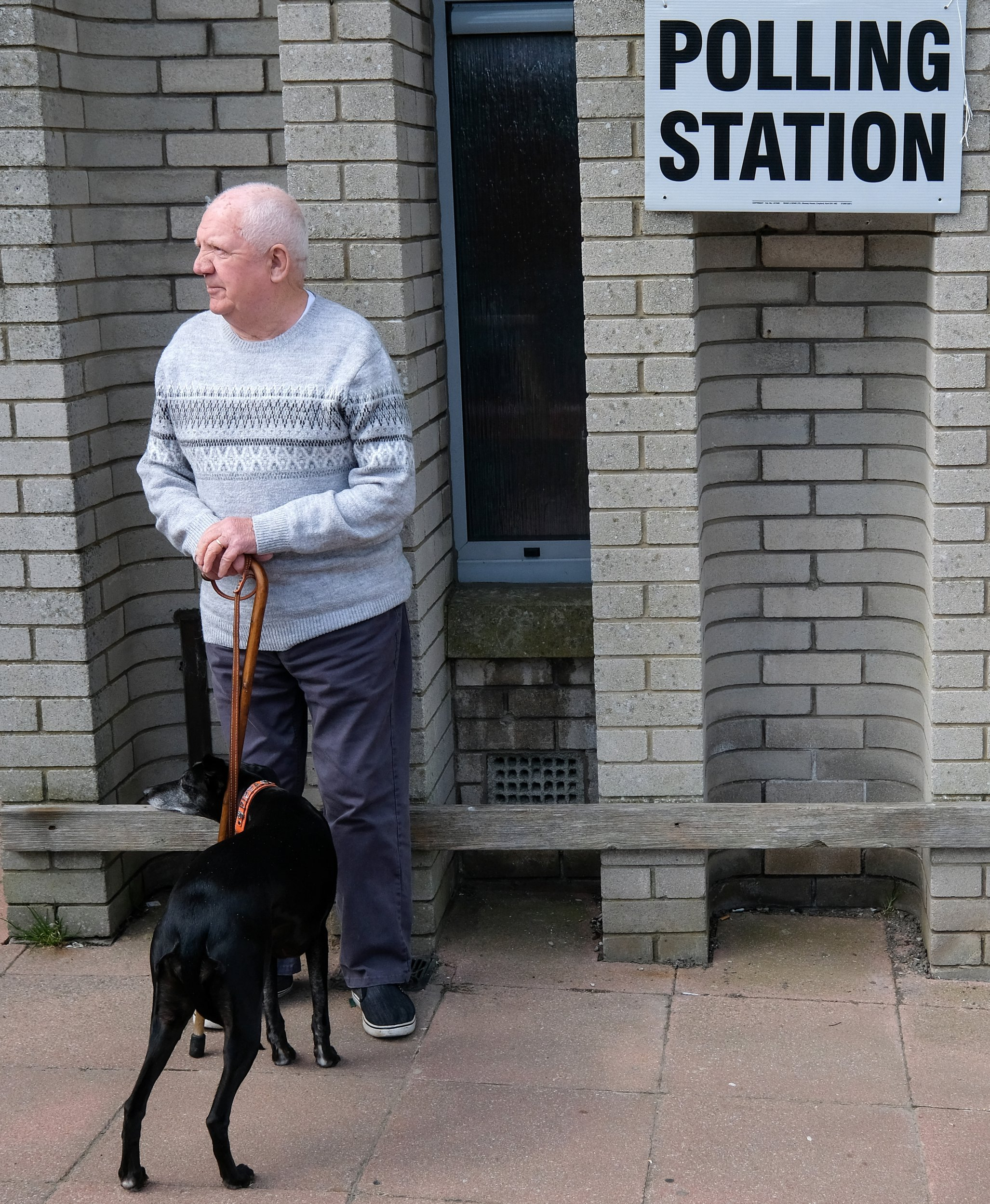 SKELTON, UNITED KINGDOM - MAY 02: A man stands with his dog outside a polling station during local elections on May 02, 2019 in Skelton, United Kingdom. Elections are being held in 248 councils across England and Northern Ireland today. (Photo by Ian Forsyth/Getty Images)
