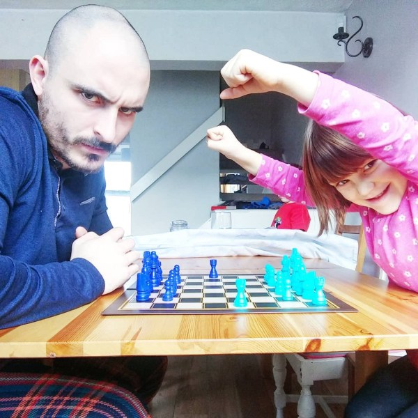 Daddy losing at chess.