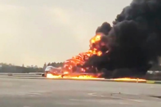 This image taken from video and provided on the Twitter feed of Mikhail Norenko, shows smoke from a plane on fire at Moscow's Sheremetyevo airport on Sunday, May 5, 2019. (Mikhail Norenko/Twitter via AP)