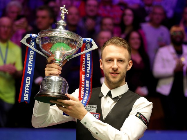 Judd Trump celebrates with the trophy after winning the 2019 Betfred World Championship at The Crucible, Sheffield. PRESS ASSOCIATION Photo. Picture date: Monday May 6, 2019. See PA story SNOOKER World. Photo credit should read: Richard Sellers/PA Wire