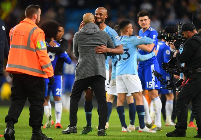 MANCHESTER, ENGLAND - MAY 06: Josep Guardiola, Manager of Manchester City celebrates victory with Vincent Kompany of Manchester City after the Premier League match between Manchester City and Leicester City at Etihad Stadium on May 06, 2019 in Manchester, United Kingdom. (Photo by Michael Regan/Getty Images)