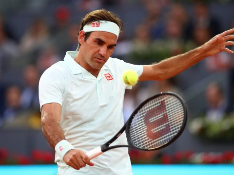 Roger Federer reacts after making winning clay court return