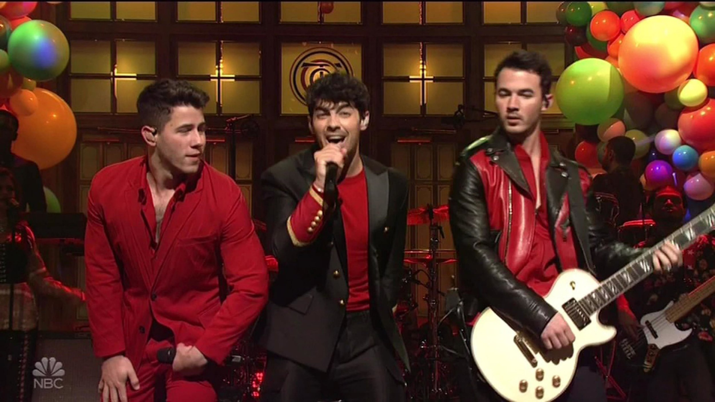 The Jonas Brothers perform on Saturday Night Live for the first time in 10 years. Pictured: Joe, Nick and Kevin Jonas