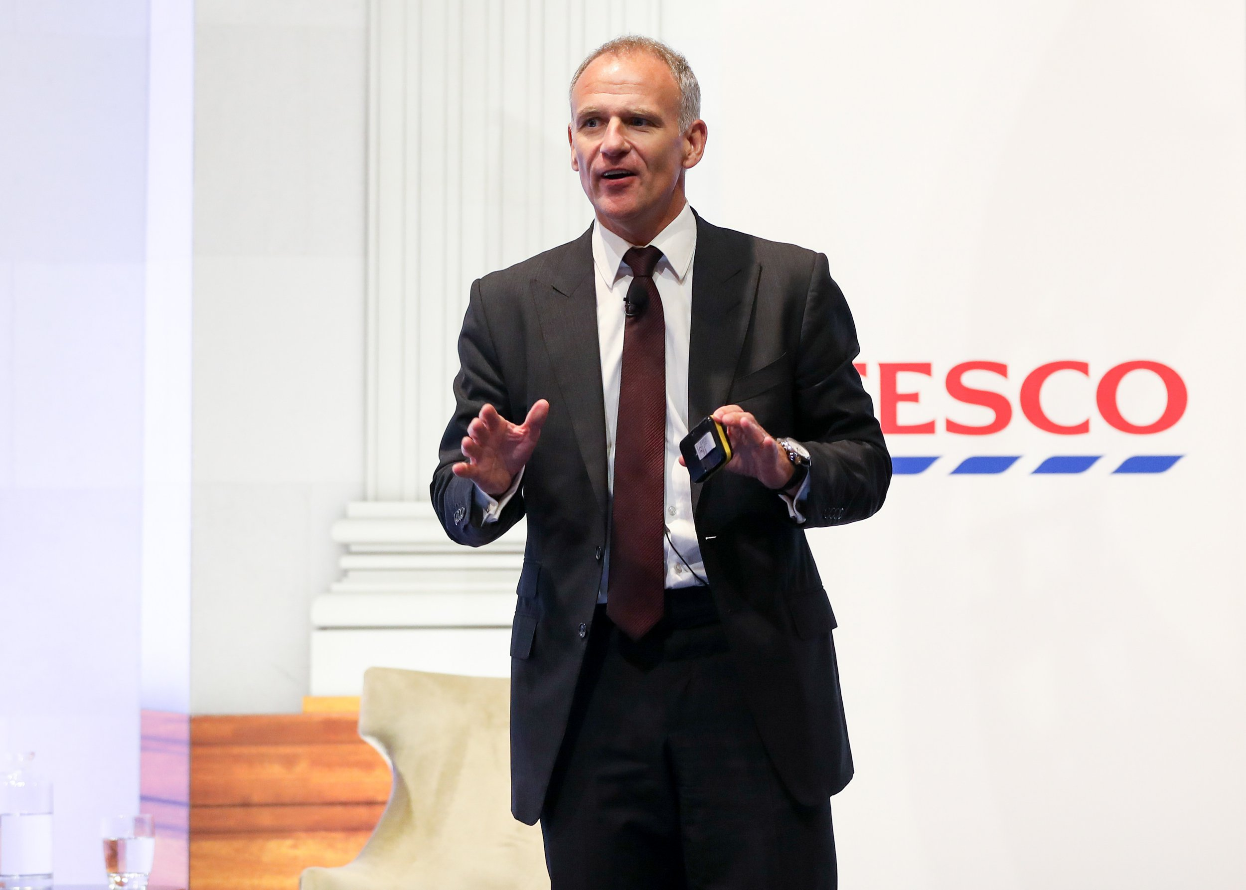 Dave Lewis, chief executive officer of Tesco Plc, gestures while speaking during a news conference in London, U.K., on Friday, Jan. 27, 2017. Tesco agreed to buy Booker Group Plc for about 3.7 billion pounds ($4.6 billion), pooling the U.K.s biggest supermarket chain with the No. 1 food wholesaler and gaining access to the fast-growing market to supply restaurants and hotels. Photographer: Simon Dawson/Bloomberg via Getty Images