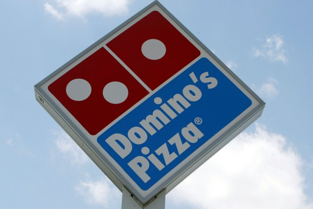 MIAMI, FL - APRIL 14: A sign in front of a Domino's Pizza April 14, 2004 in Miami, Florida. Domino's Pizza is looking to raise $300 million in the stock market by listing on the New York Stock exchange. The Michigan-based firm already has a London stock market listing for its UK subsidiary. According to media reports, the funds raised may be used to pay off debts. The 44-year-old firm now has 7,400 outlets in more than 50 countries. The firm is reporting that pizza sales are up 5.8% in 2003. (Photo by Joe Raedle/Getty Images)