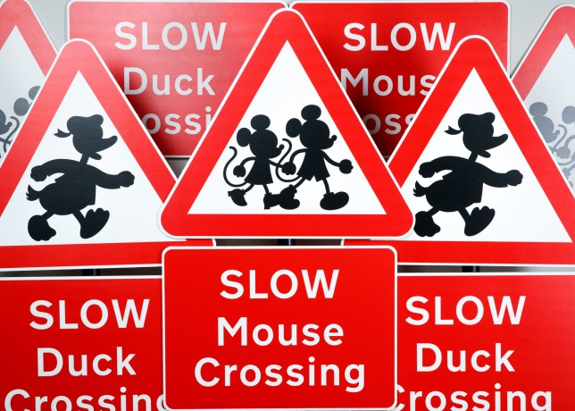 The road signs featuring mickey and minnie and donald duck