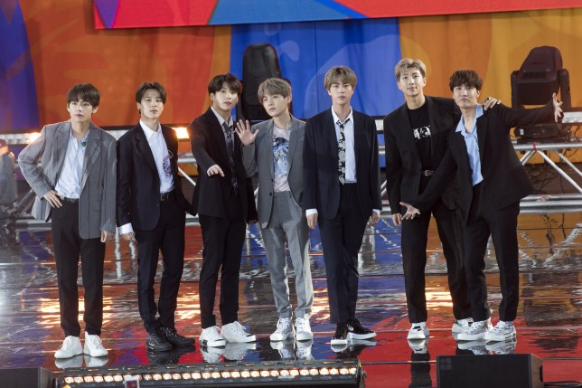 "NEW YORK, NY - MAY 15: (L-R) Kim Tae-hyung, Park Ji-min, Jungkook, Suga, Kim Seok-jin, RM and J-Hope of BTS perform on ""Good Morning America's Summer Concert Series"" from Rumsey Playfield in Central Park on May 15, 2019 in New York City. (Photo by Debra L Rothenberg/FilmMagic)"