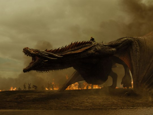 Emilia Clarke as Daenerys Targaryen riding Drogon in Game Of Thrones