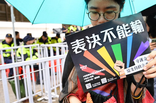 """A gay right supporter holds a placard reading """"cant lost the votes"""" outside Parliament while law makers discusses the same sex marriage bill in Taipei on May 17, 2019. - Taiwan's parliament began debating Asia's first gay marriage law as conservative lawmakers launch a last-ditch attempt to scupper the most progressive bill in favour of a watered-down """"civil-union"""" law. (Photo by Sam YEH / AFP)SAM YEH/AFP/Getty Images"""