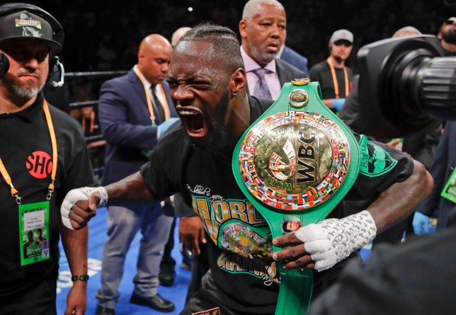 Deontay Wilder poses for photographers after his win in the WBC heavyweight championship boxing match against Dominic Breazeale on Saturday, May 18, 2019, in New York. (AP Photo/Frank Franklin II)