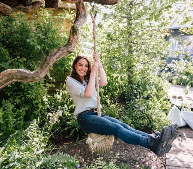 Duchess of Cambridge, Kate Middleton, swinging in the garden she designed for Chelsea Flower Show