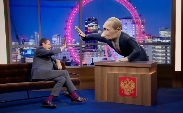 """EMBARGOED TO 0001 WEDNESDAY MAY 22 For use in UK, Ireland or Benelux countries only Undated BBC handout photo of Alistair Campbell speaking to a 3D digital cartoon of Vladimir Putin, who will be the new chat show host for a new chat show. PRESS ASSOCIATION Photo. Issue date: Wednesday May 22, 2019. Tonight With Vladimir Putin will see """"a 3D digital cartoon"""" of the Russian president """"walk around and sit behind the desk, interviewing real human guests in front of a studio audience, all in real-time"""". See PA story SHOWBIZ Putin. Photo credit should read: BBC/PA Wire NOTE TO EDITORS: Not for use more than 21 days after issue. You may use this picture without charge only for the purpose of publicising or reporting on current BBC programming, personnel or other BBC output or activity within 21 days of issue. Any use after that time MUST be cleared through BBC Picture Publicity. Please credit the image to the BBC and any named photographer or independent programme maker, as described in the caption."""
