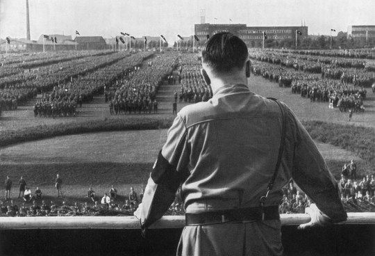 German Fuhrer and Nazi leader Adolf Hitler (1889 - 1945) addresses soldiers with his back facing the camera at a Nazi rally in Dortmund, Germany. (Photo by Hulton Archive/Getty Images)