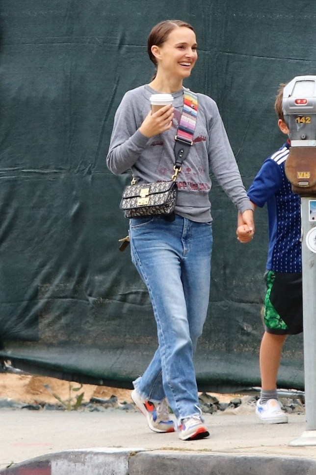 Los Feliz, CA - *EXCLUSIVE* Natalie Portman and Benjamin Millepied take their son Aleph on a coffee run in Los Feliz. The family walk holding hands as they enjoy each others company on a rare rainy day in LA. Pictured: Natalie Portman BACKGRID USA 22 MAY 2019 BYLINE MUST READ: Osvaldo / BACKGRID USA: +1 310 798 9111 / usasales@backgrid.com UK: +44 208 344 2007 / uksales@backgrid.com *UK Clients - Pictures Containing Children Please Pixelate Face Prior To Publication*