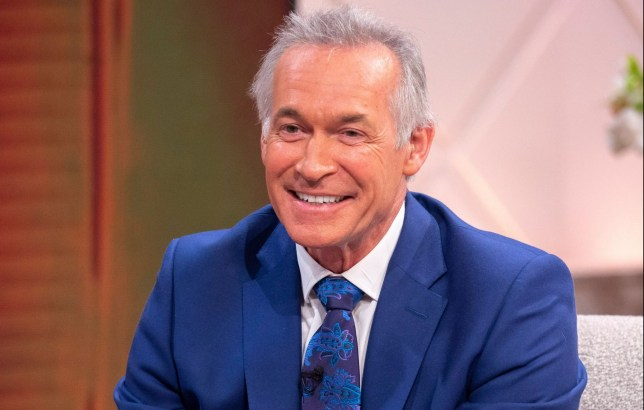Editorial use only Mandatory Credit: Photo by Ken McKay/ITV/REX/Shutterstock (10245407aq) Dr Hilary Jones 'Lorraine' TV show, London, UK - 23 May 2019 Dr Hilary Jones presented with a cake for his 30 years of giving advice on tv.
