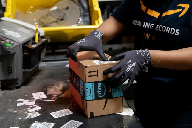 An employee packs a box at the Amazon.com Inc. fulfillment center in Robbinsville, New Jersey, U.S., on Thursday, June 7, 2018. Seattle-based Amazon hasn't yet announced the exact date for this year's Amazon Prime Day, the e-commerce giants big July sales promotion. Photographer: Bess Adler/Bloomberg via Getty Images