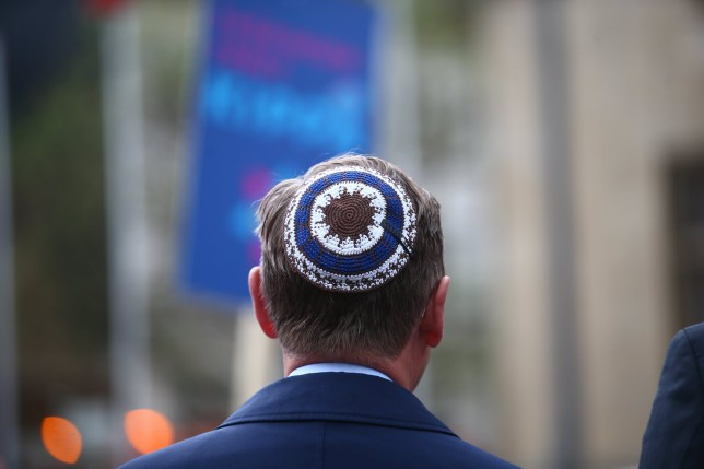 Thuringia's State Premier Bodo Ramelow wears a kippa during a rally in Erfurt, central Germany, on April 25, 2018. - Germans stage shows of solidarity with Jews after a spate of shocking anti-Semitic assaults, raising pointed questions about Berlin's ability to protect its burgeoning Jewish community seven decades after the Holocaust. (Photo by Bodo Schackow / dpa / AFP) / Germany OUT (Photo credit should read BODO SCHACKOW/AFP/Getty Images)