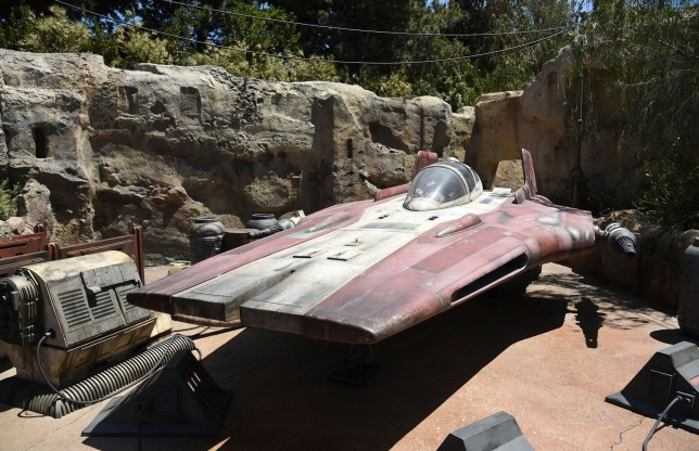 An A-wing interceptor starfighter is displayed at Star Wars: Galaxy's Edge
