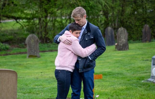 Robert and Victoria hug in Emmerdale