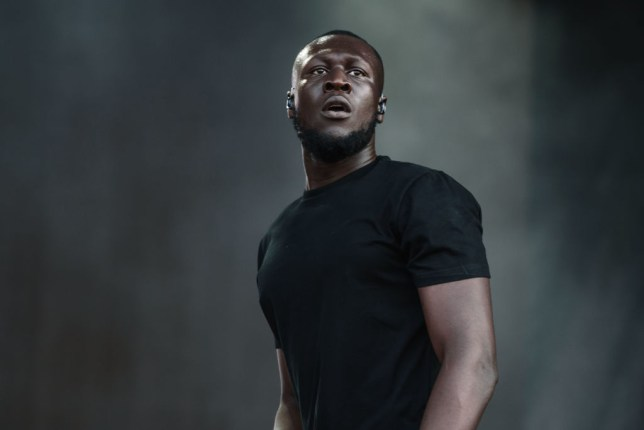 Stormzy wearing a black t-shirt and performing on stage at Sziget Festival