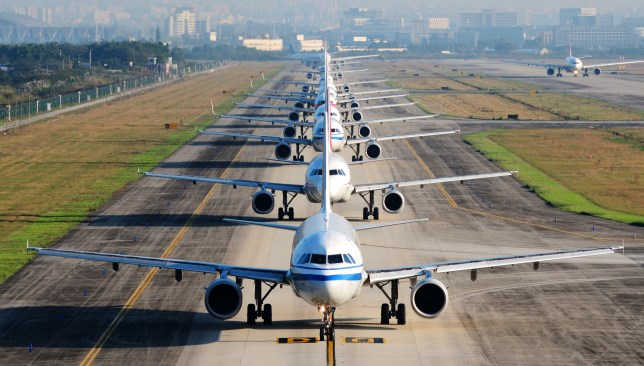 Airplanes on the tarmac in a queue to fly off