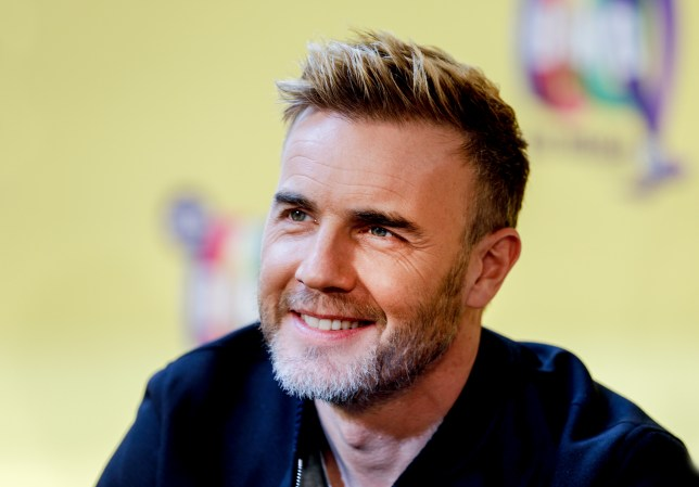 Gary Barlow has 'no shame' as he strips down to dressing gown on private jet
