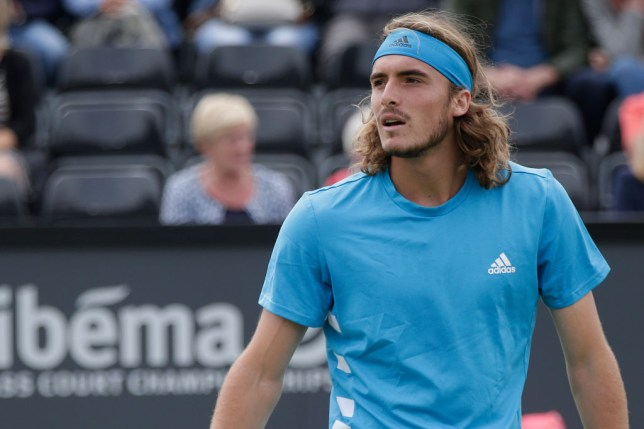 Stefanos Tsitsipas looks on as he prepares for Wimbledon in the grass-court season