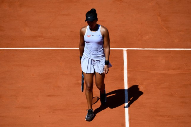 Naomi Osaka looks down as she crashes out of the French Open